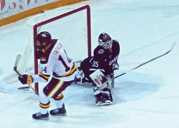 Alex Iafallo scored on UMD's first shootout turn at goaltender Evan Weninger. Photo credit: John Gilbert