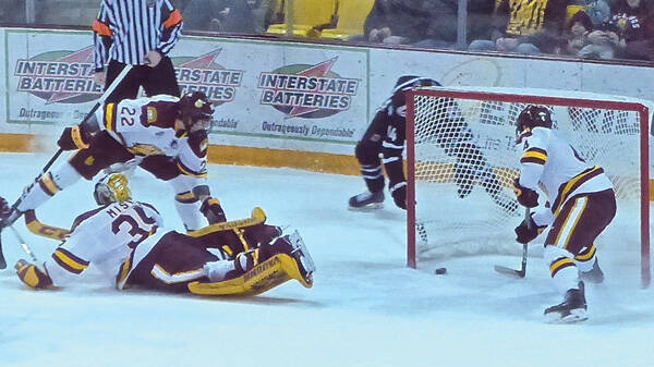 UMD defenseman Neal Pionk rescued goalie Hunter Miska by stopping the puck right on the goal line. Photo credit: John Gilbert