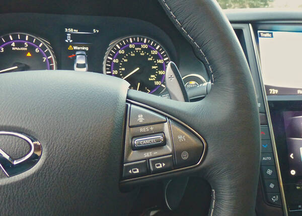 Steering wheel controls show a hint of the upshift paddle... Photo credit: John Gilbert