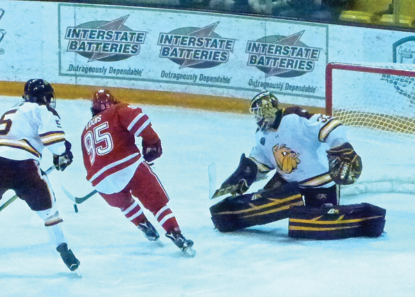 UMD sophomore goaltender Kasimir Kaskisuo came up with a big save on a short-handed breakaway by Miami's Anthony Louis, igniting a 3-goal rally by the Bulldogs in the first game.  Photo credit: John Gilbert