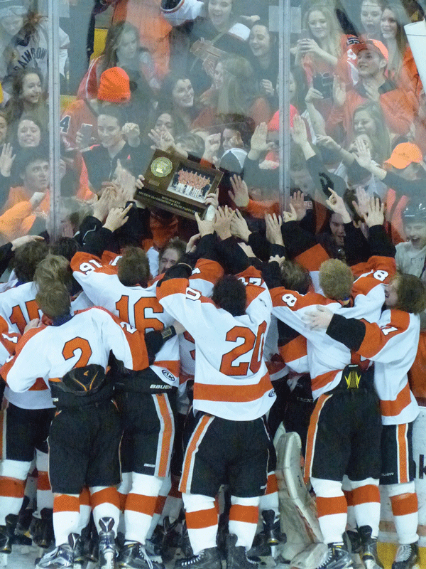 Jubilant Grand Rapids players took their Section 7AA trophy to celebrate with their fans at AMSOIL Arena. Photo credit: John Gilbert