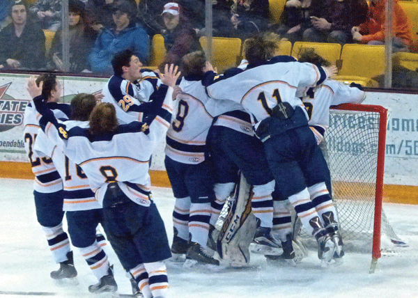 Hermantown players piled out to celebrate 8-0 Section 7A victory over Hibbing-Chisholm at AMSOIL Arena. Photo credit: John Gilbert