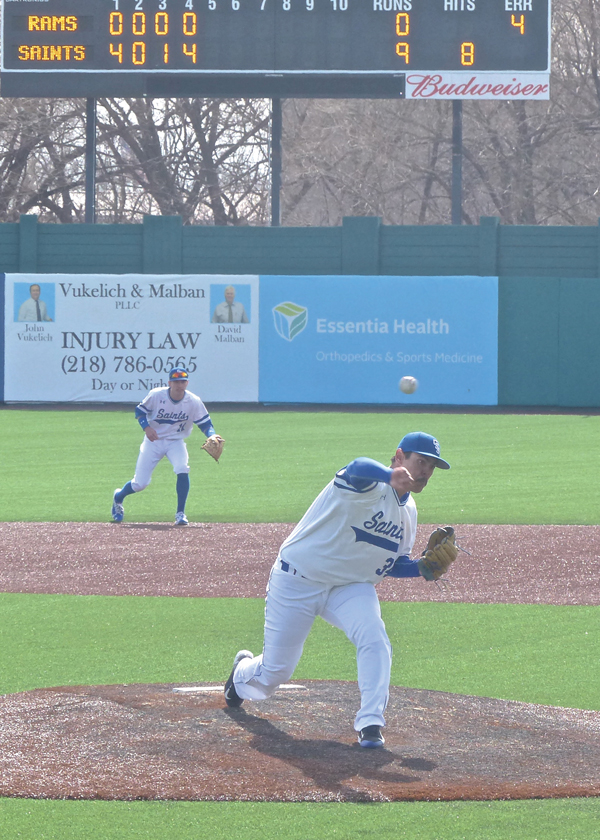 Gino Strebing got the call to start Tuesday's home opener for St. Scholastica, and the senior responded by throwing a no-hitter in a 14-1 romp over North Central at Wade Stadium. Photo credit: John Gilbert