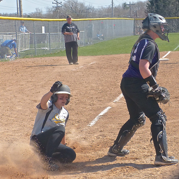 Katie Wilkie slid home with the winning run in the 8th inning of the 7-6 UWS victory over Northwestern.