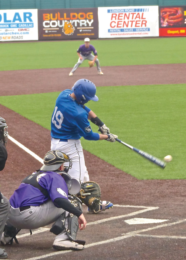 St. Scholastica's Jake Kuschke ripped a bases-loaded hit in the UMAC final against Northwestern, boosting the score from 6-3 to 9-3.  Photo credit: John Gilbert