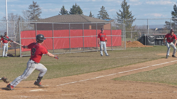 East's Nathaniel Benson hit the ball to drive in the tie-breaking run against Hibbing. Photo credit: John Gilbert