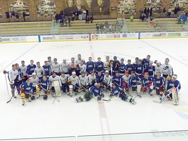 The two teams of current and former high school, junior, college and pro players gathered after the game for a joint team picture. Photo credit: John Gilbert