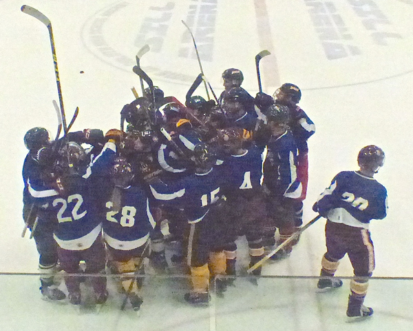 UMD women's hockey captain Ashleigh Brykaliuk (9 in Blue) was completely engulfed by her Bordson teammates after scoring in the third overtime to win the Heritage Classic 3-2. Photo credit: John Gilbert