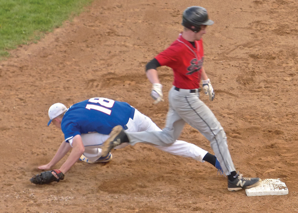 Junior John Chmielewski beat out an infield chop, and when the throw was wide and low, two runners scored to give East its 3-2 victory over Cambridge-Isanti. Photo credit: John Gilbert