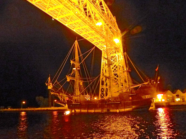El Galeon, the Spanish galleon that stayed in Duluth after the other Tall Ships departed, drew only a spontaneous crowd of appreciative onlookers as it left under the Aerial Bridge about an hour after sunset last Wednesday night. – Photos by John Gilbert.